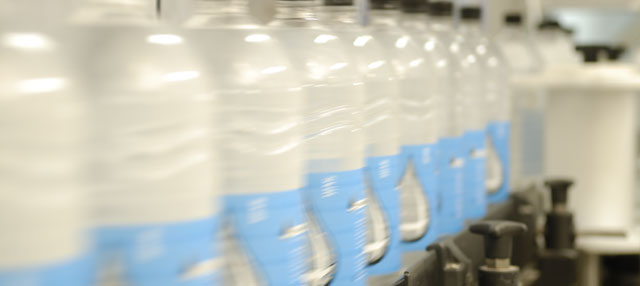 Row of two litre bottles in the bottling plant